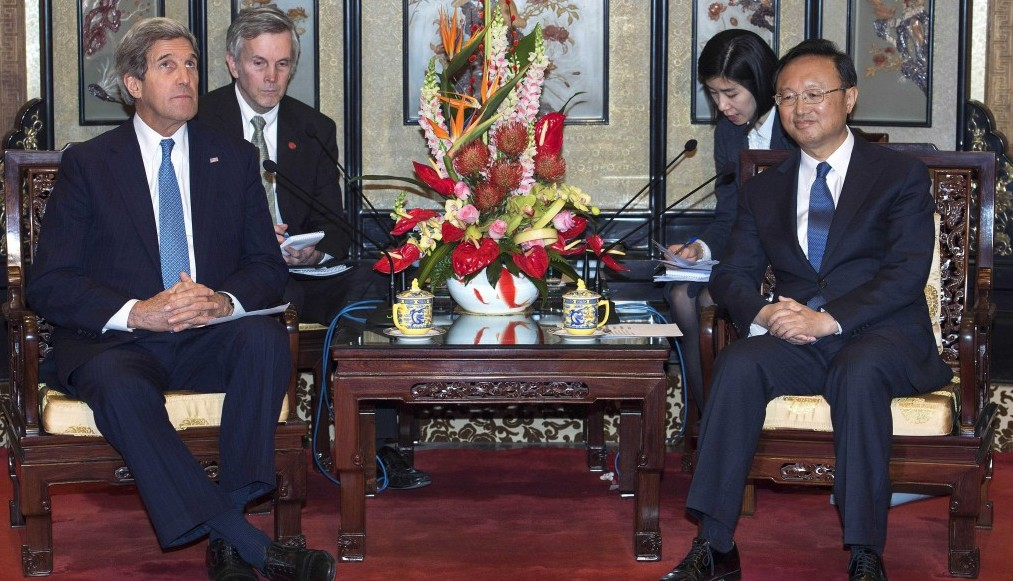 US Secretary of State John Kerry, left, meets with Chinese State Councilor Yang Jiechi in the Diaoyutai State Guesthouse Saturday, April 13, 2013 in Beijing.