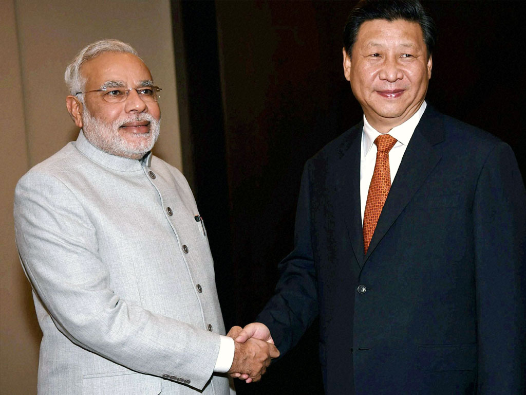 Narendra Modi and Xi Jinping stress economic relations, gloss on border dispute