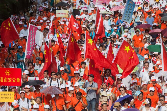 Chinese flags were flying Sunday in a protest against Occupy Central With Love and Peace, a coalition that objects to the process for picking Hong Kong's next leader. (Photo courtesy: Alex Hofford/European Pressphoto Agency)