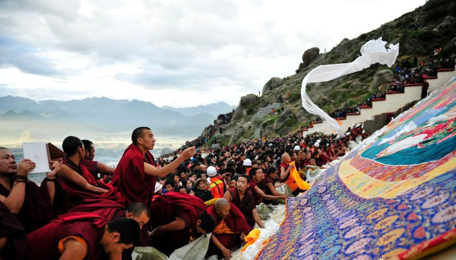 large crowd of people attending the annual Shoton, or 'Yogurt Feast', festival at Drepung Monastery in the outskirts of Tibet's capital Lhasa. The festival, which has a 17th century origin, is being held this year from Aug 25 to Sep 2.