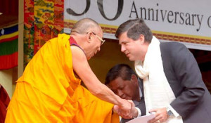 Mario Oriani-Ambrosini being greeted by the Dalai Lama during a ceremony in the Bylakuppe Tibetan settlement in South India in September 2010.