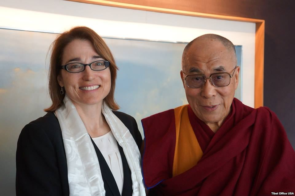 Sarah Sewall with the Dalai Lama.
