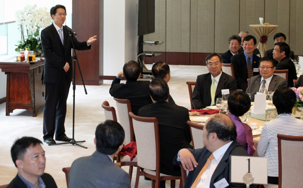 Liaison office director Zhang Xiaoming delivers a speech during the lunch.
