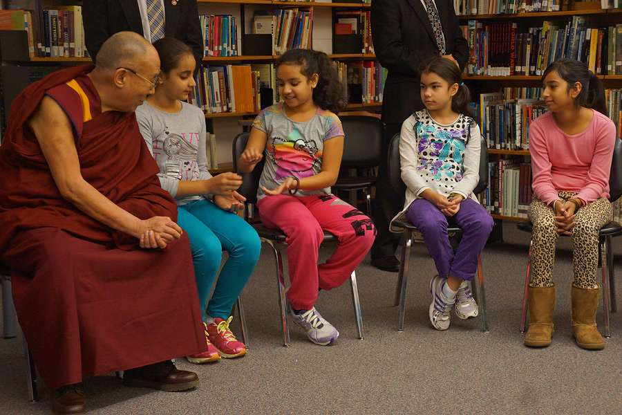 His Holiness the Dalai Lama in the junior school students' classroom talking about gratitude at John Oliver School in Vancouver, Canada on October 21, 2014. (Photo courtesy /Jeremy Russell/OHHDL)