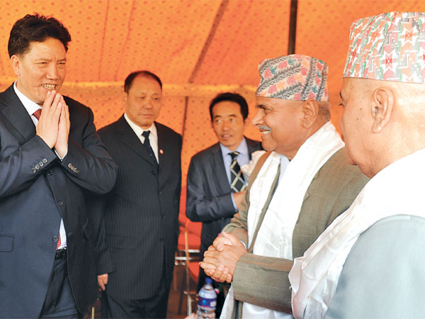 Chairman of the Government of the Tibet Autonomous Region of China Luosang Jiangcun (left) greets President Ram Baran Yadav (2nd right)and Vice-president Paramananda Jha (right) at a tea party organised at the Vice-president's office in Kantipath, Kathmandu, Nepal.