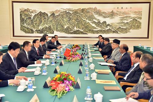 Chinese State Councilor and Minister of Public Security Guo Shengkun (4th L) holds talks with Nepali Deputy Prime Minister and Minister of Home Bam Dev Gautam (5th) in Beijing, capital of China, Oct. 16, 2014.