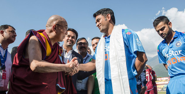 His Holiness the Dalai Lama greeting Indian Cricket Captain Mahendra Singh Dhoni before the Indian-West Indies match in Dharamsala, HP, India on October 17, 2014. (Photo courtesy /Tenzin Choejor/OHHDL)