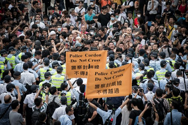 Police cordon off an area where pro-democracy demonstrators have gathered in the Admiralty district of Hong Kong, Oct. 13, 2014.