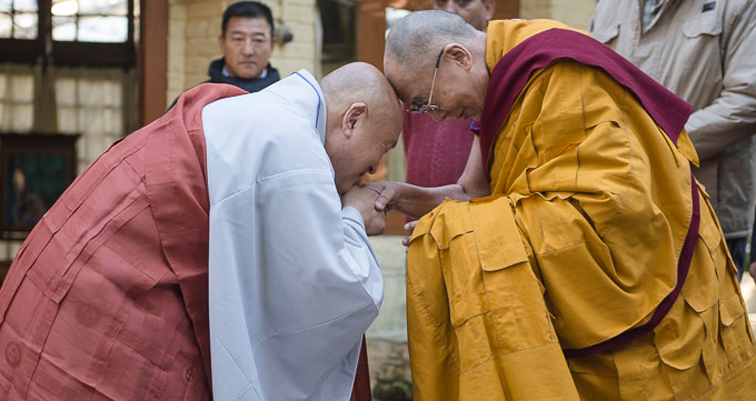 His Holiness the Dalai Lama and Ven. Jin-Ok exchanging greetings before walking to the Main Tibetan Temple at the start of the second day of His Holiness the Dalai Lama's three day teaching in Dharamsala, HP, India on November 12, 2014. (Photo courtesy/Tenzin Choejor/OHHDL)