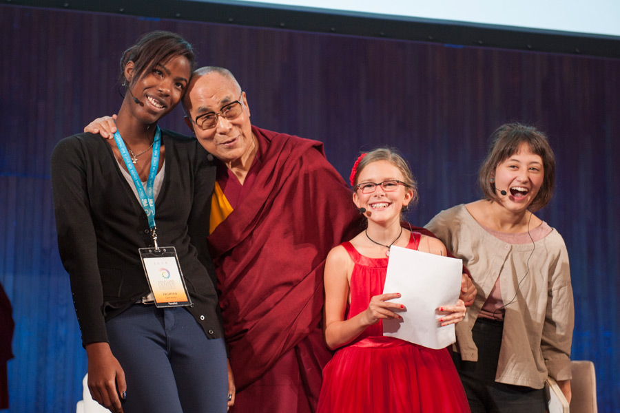 His Holiness the Dalai Lama with the young panelists at the end of a conversation that was part of the SPARK 2014 program organized by the Dalai Lama Center for Ethics and Transformative Values at MIT's Kresge Auditorium in Cambridge, MA, USA on October 31, 2014. (Photo courtesy/Brian Lima and OHHDL)