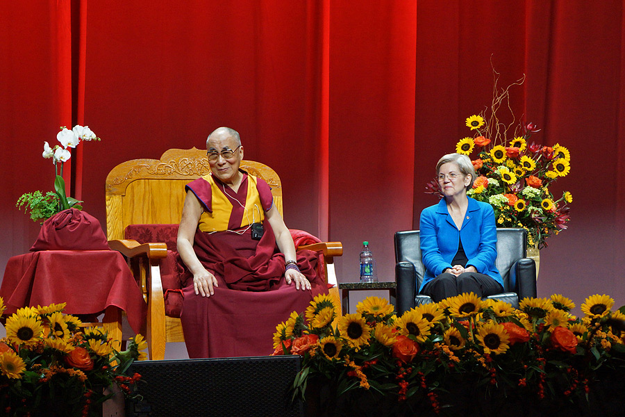 His Holiness the Dalai Lama and US Senator Elizabeth Warren watching members of the Tibetan community performing traditional songs at the start of his public talk in Boston, MA, USA on November 1, 2014. (Photo courtesy/Jeremy Russell/OHHDL)
