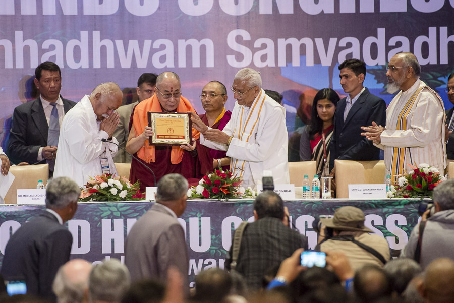 A certificate honoring His Holiness the Dalai Lama being presented at the inaugural session of the 1st World Hindu Congress in New Delhi, India on November 21, 2014. (Photo courtesy/Tenzin Choejor/OHHDL)
