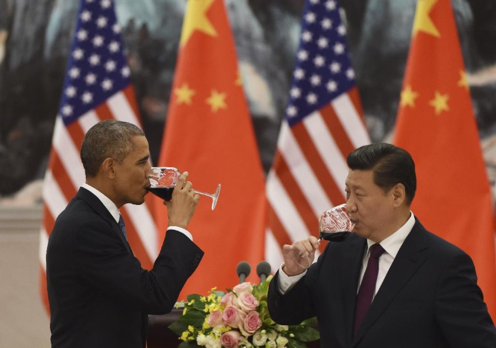 U.S. President Barack Obama, left, and Chinese President Xi Jinping drink a toast at a lunch banquet in the Great Hall of the People in Beijing Wednesday, Nov. 12, 2014. Obama is on a state visit after attending the Asia-Pacific Economic Cooperation summit.  (Photo courtesy: AP)