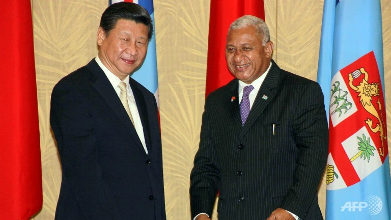 Fiji's Prime Minister Voreqe Bainimarama (R) and the visiting Chinese President Xi Jinping pose for pictures in Nadi. (Photo courtesy: AFP)