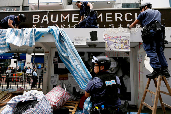 Police officers cleared the last remaining protest site in the Causeway Bay district of Hong Kong on Monday. (Photo courtesy/ Athit Perawongmetha/Reuters)