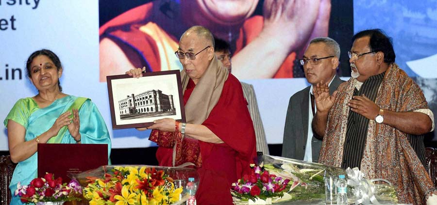 The Dalai Lama with Anuradha Lohia, Vice-Chancellor of Presidency University, joined on stage also by the State's Education Minister Mr Partha Chatterjee at the University's Deriozio Hall in Kolkata, West Bengal, India on January 13, 2015. (Photo courtesy:  PTI: Metro Vaartha)