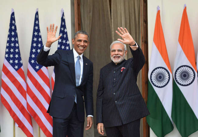 Prime Minister Narendra Modi (right) and US President Barack Obama wave before a meeting at Hyderabad House in New Delhi on Sunday. (PTI Photo)