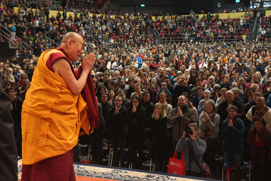His Holiness the Dalai Lama' waves to the audience at the conclusion of the day's teaching at St. Jakobshalle in Basel, Switzerland on February 7, 2015. (Photo courtesy/Jeremy Russell/OHHDL)