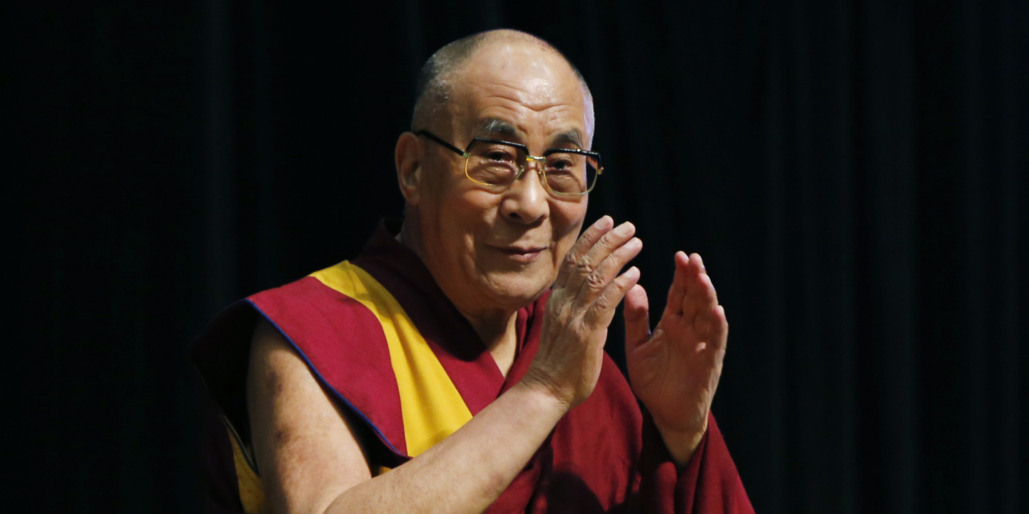 Tibetan spiritual leader the Dalai Lama greets an audience before his religious speech in Tokyo, Monday, Nov. 25, 2013. (Photo courtesy/AP Photo/Koji Sasahara)