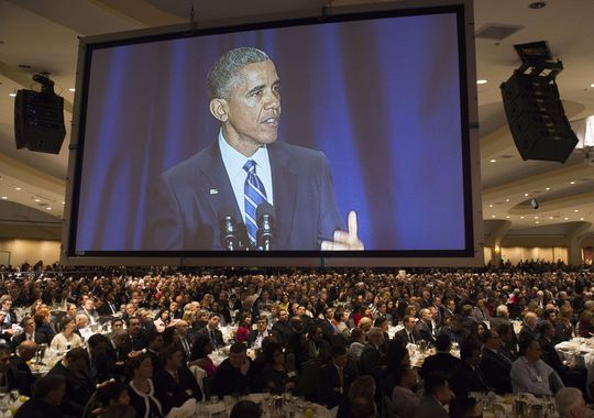 President Obama appears on a screen as he speaks during the National Prayer Breakfast in Washington on Feb. 5, 2015. (Photo courtesy: usatoday.com)