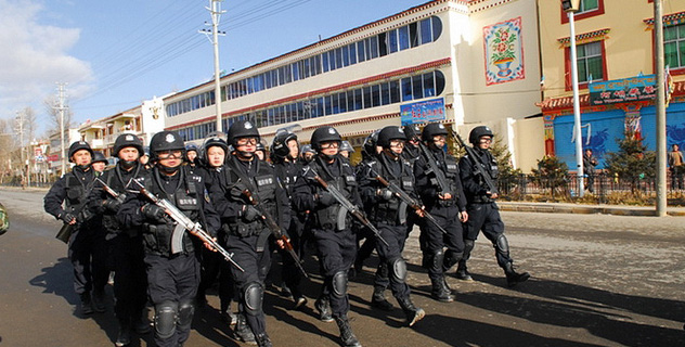 People's Liberation Army in full riot gear marches in Ngaba (Ch: Aba) in Tibet's Amdo province on 30 November 2011. (Photo courtesy: tibet.net)