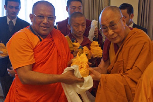 His Holiness the Dalai Lama presenting a member of delegation of senior Sri Lankan monks with a Buddha statue after their meeting in New Delhi, India on March 19. 2015. (Photo courtesy/Jeremy Russell/OHHDL)
