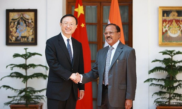 India's National Security Adviser Ajit Kumar Doval, right, and Chinese State Councilor Yang Jiechi shake hands before the start of the 18th round of talks on India-China border dispute in New Delhi, India, Monday, March 23, 2015.