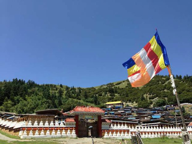 Buddhist flag flies in front of Drakkar Choeling nunnery, Kardze, in an undated photo. (Photo courtesy: RFA)