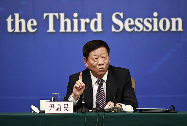Yin Weimin, minister of human resources and social security, speaks at a press conference on the sidelines of the National People's Congress annual session in Beijing, March 10, 2015. (Photo courtesy/China Daily)