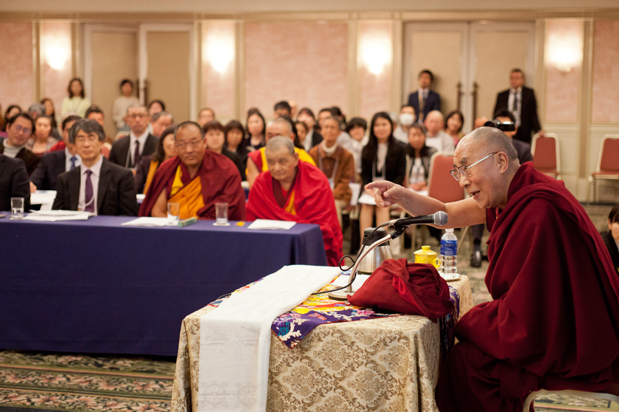 His Holiness the Dalai Lama speaking at the conference on Buddhist studies in Tokyo, Japan on April 5, 2015. (Photo courtesy/Tenzin Jigmey/OHHDL)