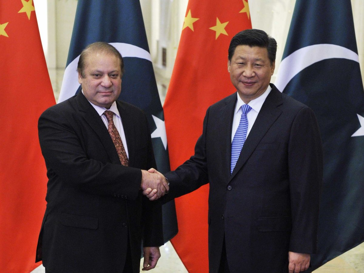 Pakistan's Prime Minister Nawaz Sharif shakes hands with China's President Xi Jinping. (Photo courtesy: Reuters)