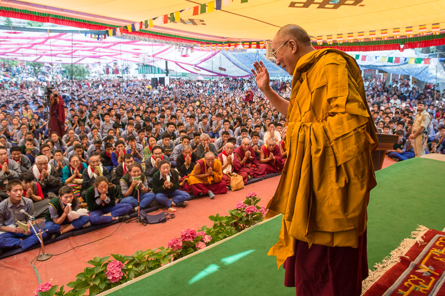 His Holiness the Dalai Lama waving to the crowd at the conclusion of the Avalokitehsvara Empowerment and Long Life Offering ceremony at Tibetan Children's Village School (TCV) in Upper Dharamsala, HP, India on May 29, 2015. (Photo courtesy/Tenzin Choejor/OHHDL)