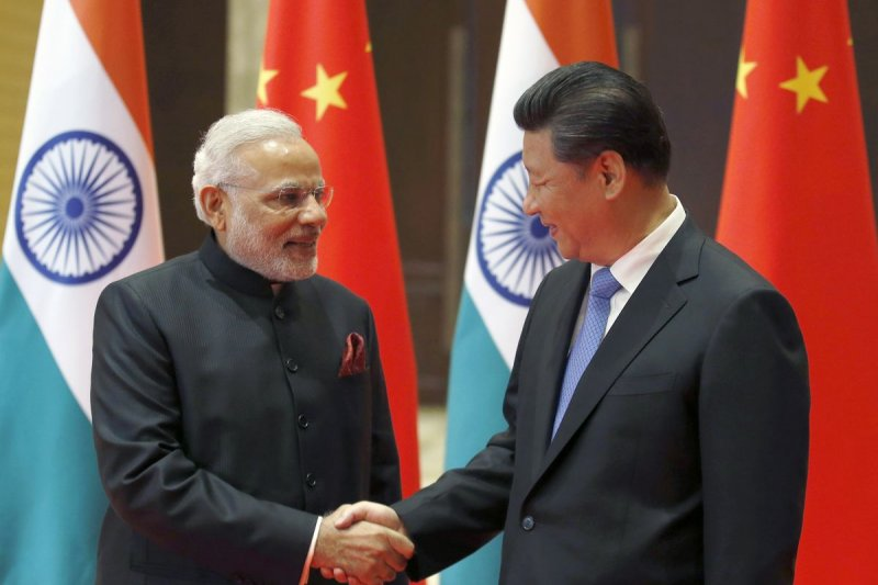 China scolds India on border, Dalai Lama issues ahead of PM Modi's visit