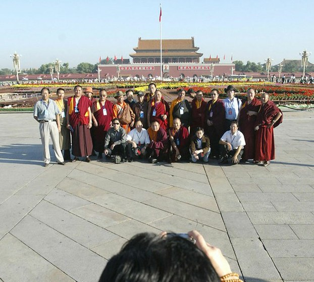 Tibetans pose for a group photo at Beijing's Tiananmen Square in undated photo. (Photo courtesy: RFA)