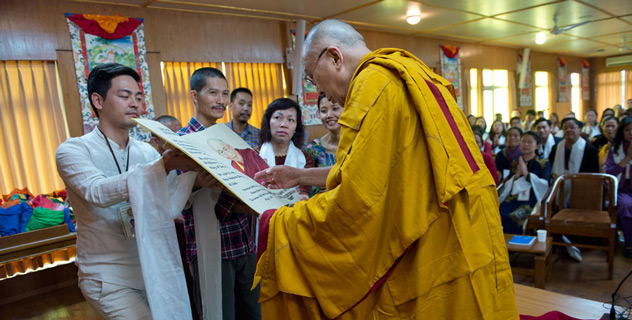 "Members of the Vietnam CEO Club offering His Holiness the Dalai Lama a copy of Shantideva's ""Guide to the Bodhisattva's Way of Life"" during their meeting at his residence in Dharamsala, HP, India on May 15, 2015. (Photo courtesy/Tenzin Choejor/OHHDL)"