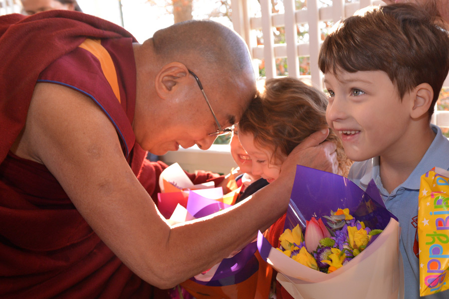 His Holiness the Dalai Lama greeting young children who came to welcome him on his arrival in Leura, Blue Mountains, NSW, Australia on June 4, 2015. (Photo courtesy/Rusty Stewart/OHHDL)