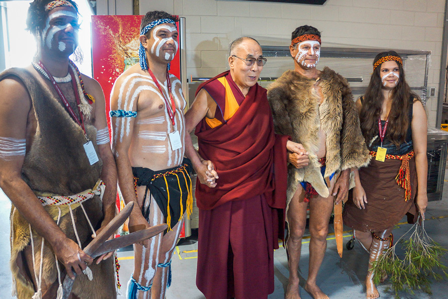 His Holiness the Dalai Lama with indigenous dancers who performed before his talk at the Perth Arena in Perth, WA, Australia on June 14, 2015. (Photo courtesy/Jeremy Russell/OHHDL)