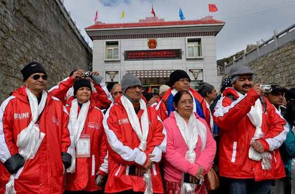 Indian pilgrims travelling to Mount Kailash and Lake Manasarovar in western Tibet's Ngari Prefecture. Fifty pilgrims started their 12-day journey through the newly opened Nathu-La pass, which is a border point between Chinese ruled Tibet and the Indian state of Sikkim.