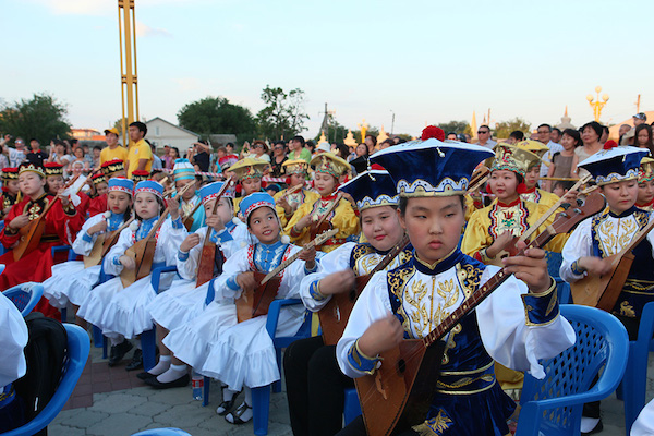 In the Russian Buddhist Republic of Kalmykia. Over 300 musicians and children played Dombra at the ceremony to celebrate His Holiness the Dalai Lama's 80th birthday.