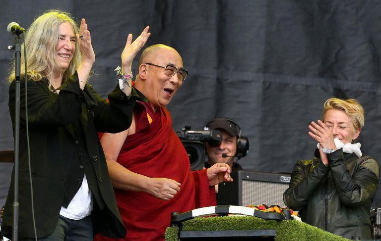 His Holiness the Dalai Lama joined Patti Smith on the Pyramid Stage where she presented him with a birthday cake and he got a rendition of Happy Birthday from the crowd. (Photo courtesy: http://metro.co.uk/)
