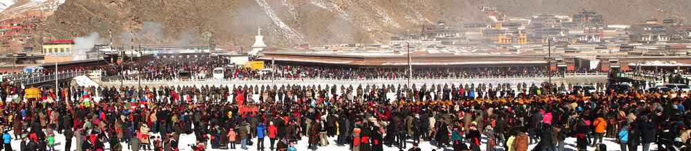 At Labrang monastery, one of the largest monasteries in Amdo, throngs of pilgrims wait for the unveiling of an enormous thangka on the festival day of Monlam. They are watched by a formation of People's Armed Police which stretches along the entire length of the Sangchu River in town.  (Photo courtesy: Savetibet.org)