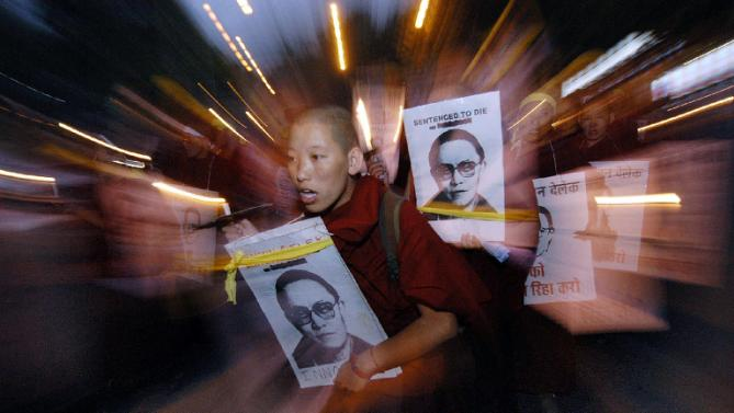 China expresses scorn at outrage over Tibetan monk political prisoner's death