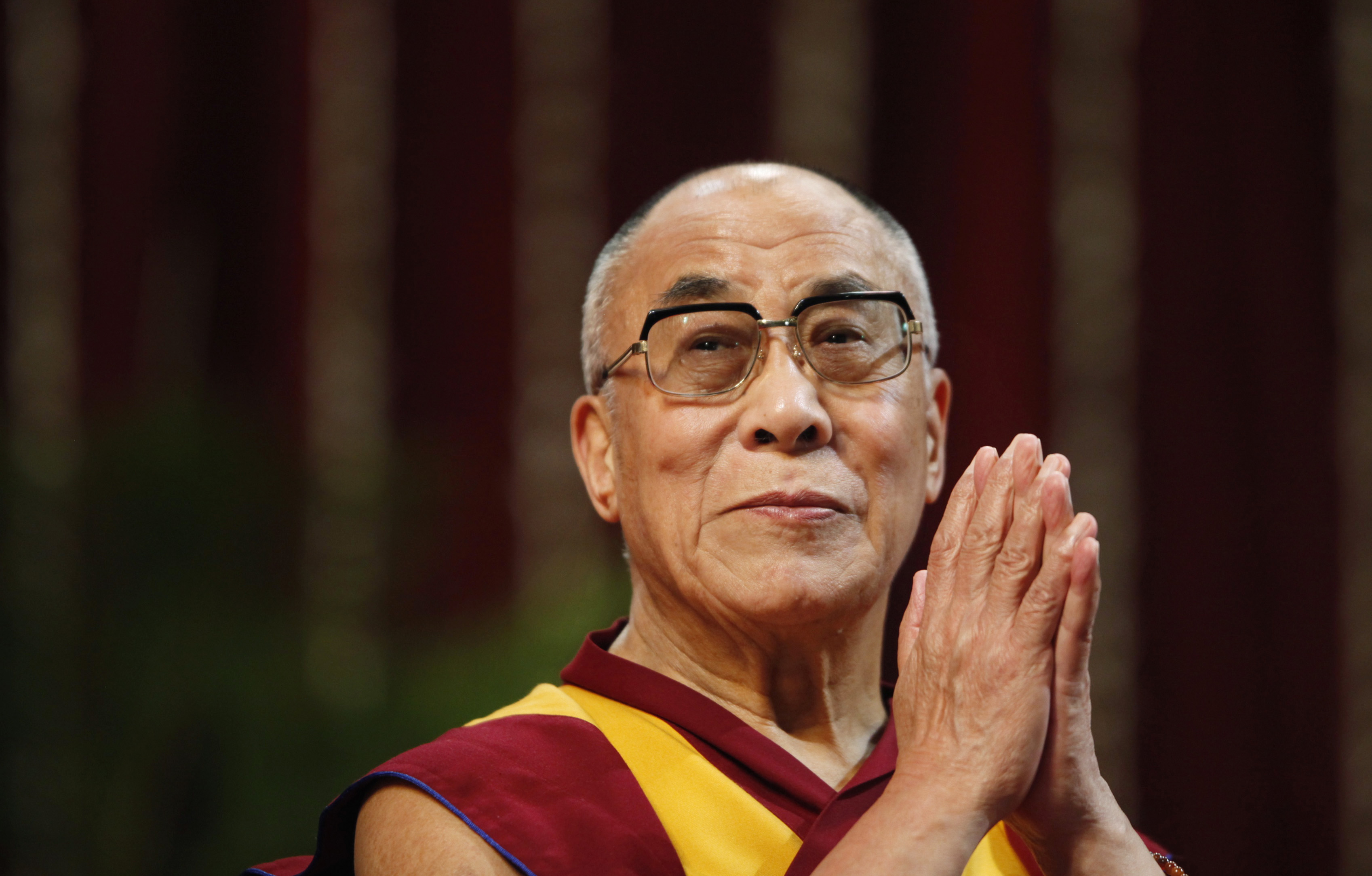 The Dalai Lama gestures before speaking to students during a talk at Mumbai University February 18, 2011. (Photo Courtesy: REUTERS)