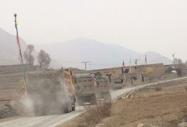 Mining trucks move along a road in Yadzi county, Qinghai, in an undated photo. (Photo courtesy: RFA)