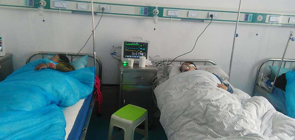 Tibetans admitted in hospitals after a brutal assault by Chinese policemen in Nangchen County. (Photo courtesy: Tibet.net)