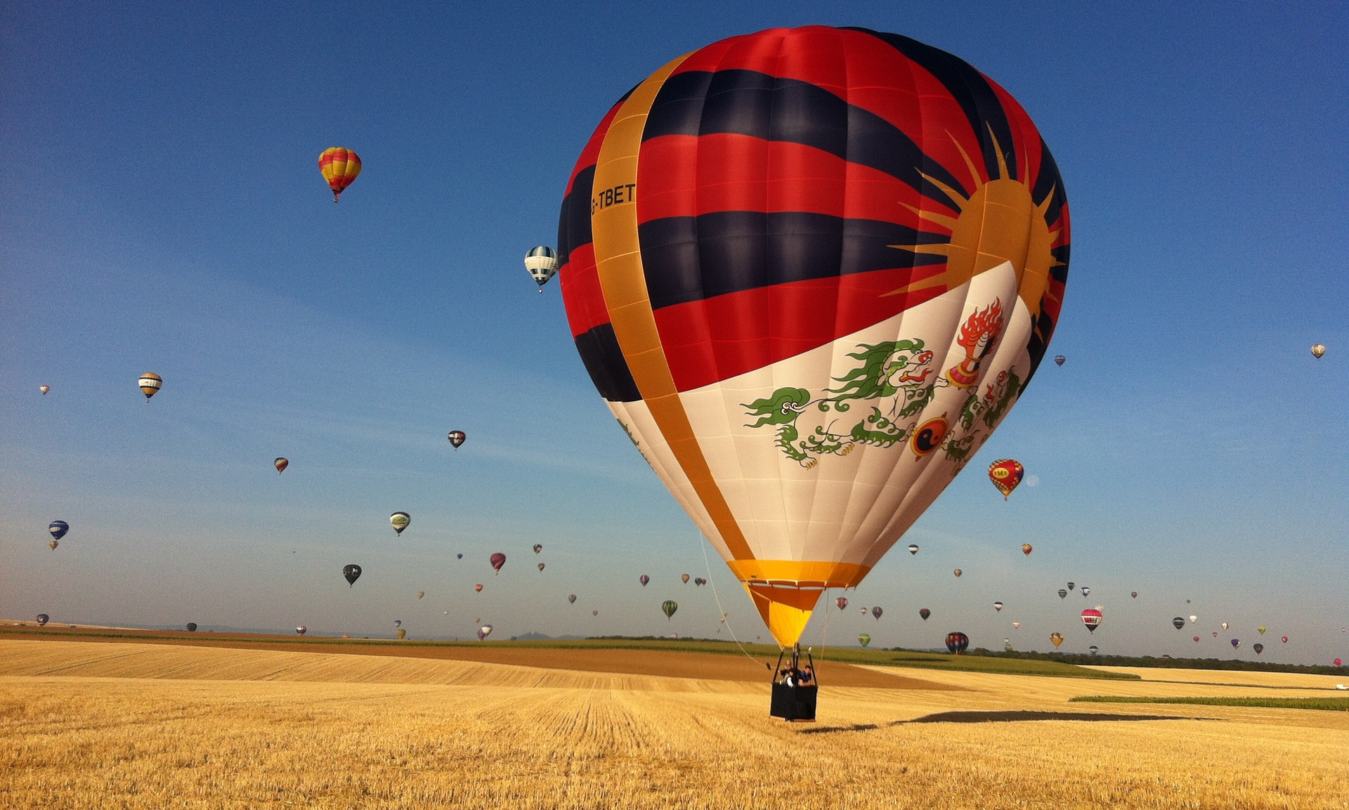 Shadowy Chinese officials try to ground festival's Tibet balloon. (Photo courtesy: The Guardian)