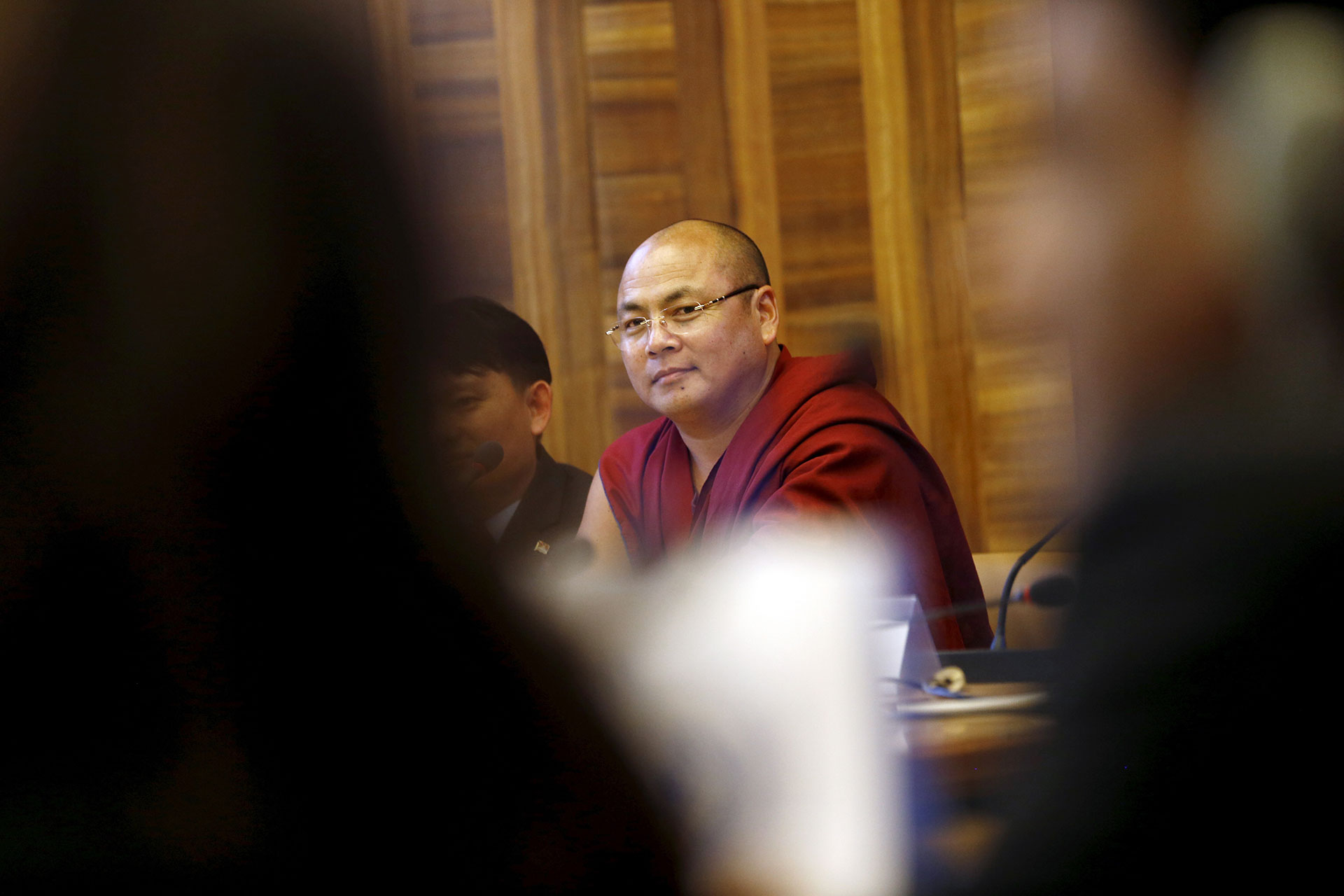 Tibetan monk Golog Jigme, who escaped from detention in China in 2012, addressing a side event during the June session this year of the United Nations Human Rights Council in Geneva. He and other activists say Chinese agents are hounding them at the U.N. body. ( Photo courtesy: REUTERS)