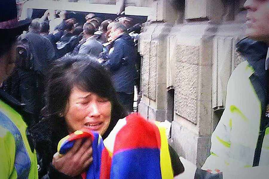 Jamphel Lhamo (33)  arrested by Metropolitan police officers. (Photo courtesy: Tibetan Community UK/PA)