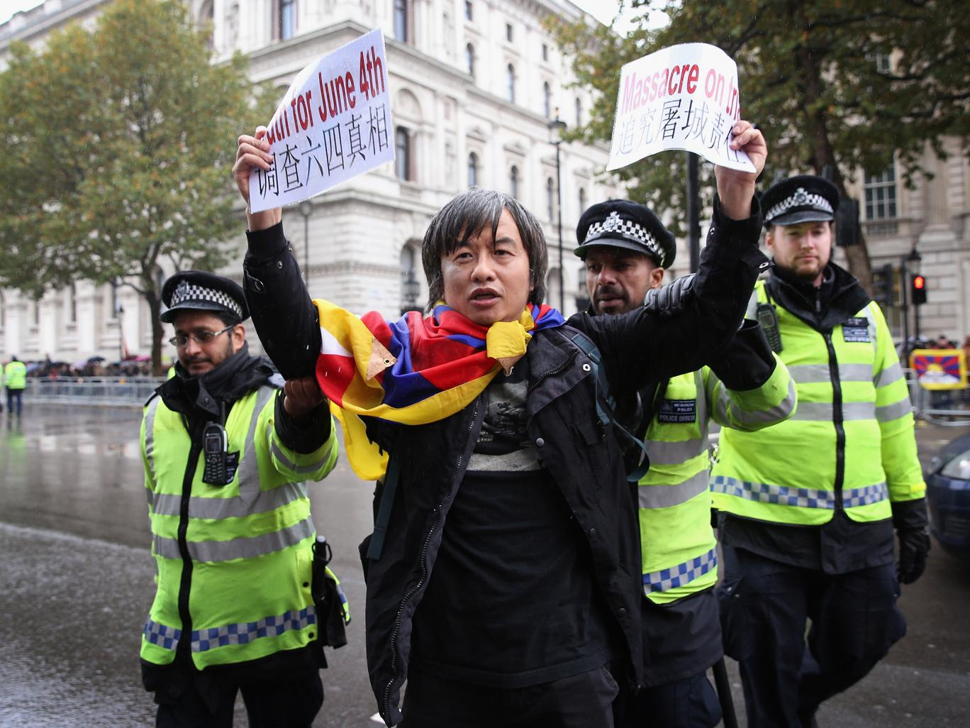 Shao Jiang protests outside Downing Street on Wednesday ahead of the arrival of Chinese President Xi Jinping. (Photo courtesy: independent.co.uk)