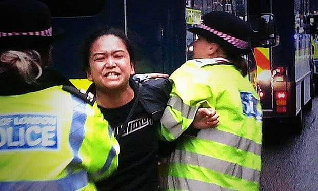 Tibetan activist Sonam Choden, 31, is arrested by Metropolitan police officers. (Photo courtesy: Tibetan Community UK/PA)